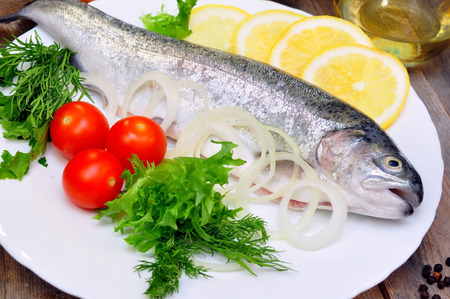 rainbow trout with lemon and fresh vegetables photo