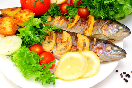 grilled trout with fresh herbs, vegetables photo