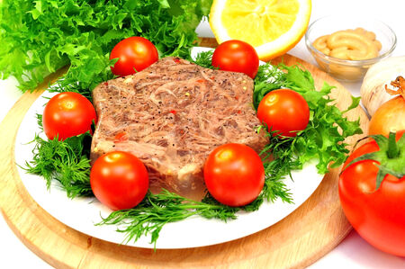 jellied meat with fresh herbs and cherry tomatoes photo