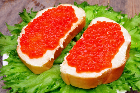 sandwiches with salmon caviar in a plate
