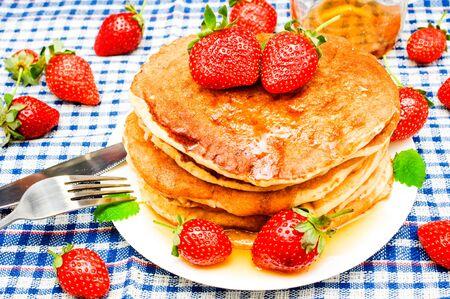 pancakes with fresh berries and honey Stock Photo