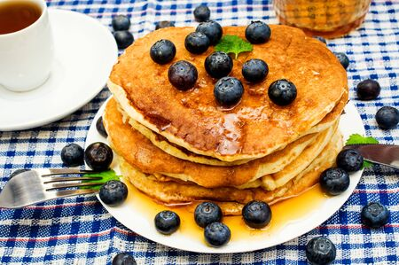pancakes with berries and tea Stock Photo