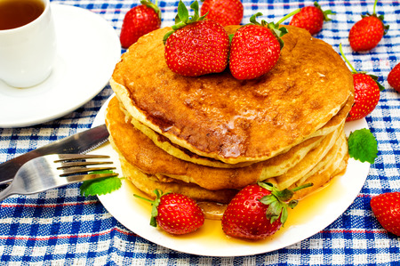 pancakes with strawberries and tea Stock Photo