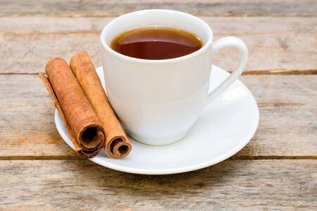 tea with cinnamon on wooden table Stock Photo