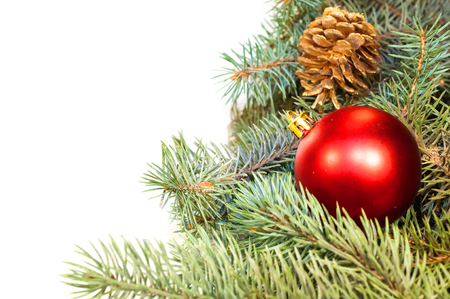 Christmas tree branches with cones, gifts and toys on a white background