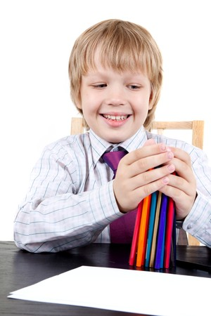 Boy holding color pencils Stock Photo - 7072507