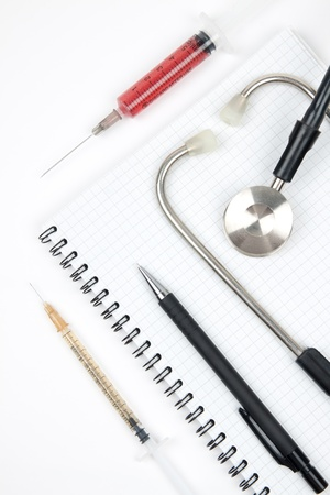 Notebook and stethoscope photo