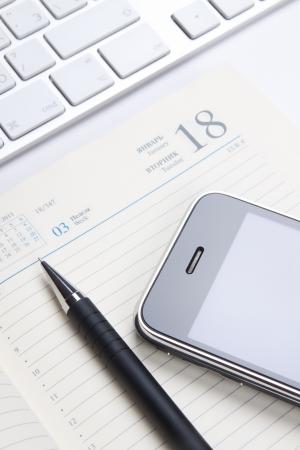 diary and phone Banco de Imagens