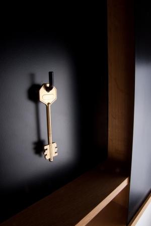 doorlock: Key on a hook Stock Photo