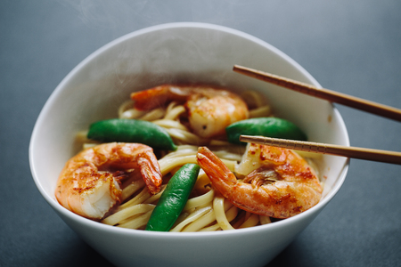 chinese spinach: hot noodles with shrimps on a black background Stock Photo