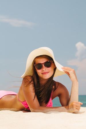 Young beautiful woman lying on an exotic beach Banco de Imagens
