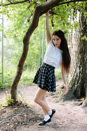 Attractive girl in dress posing outdoor 写真素材