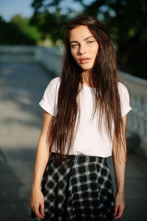 Attractive girl in dress posing outdoor Banco de Imagens