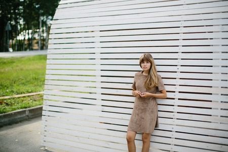 young beautiful girl posing in the park Banco de Imagens