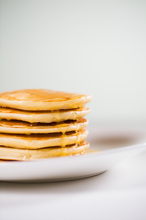 Stack of Small pancakes in syrup 写真素材