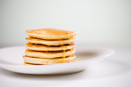 Stack of Small pancakes in syrup Banco de Imagens