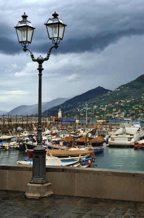 waterfront: Street lantern on the waterfront in the port of Camogli, Italy