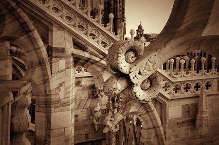 buttresses: Detail of sculptures on the roof of the Duomo in Milan, Lombardy, Italy