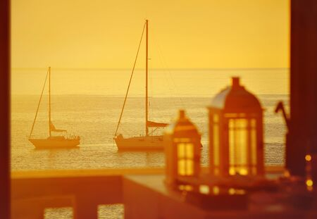yachts: Terrace with lanterns and views of the sea from yachts
