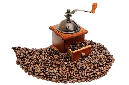 coffee grinder: Old coffee grinder with coffee grains on a white background Stock Photo