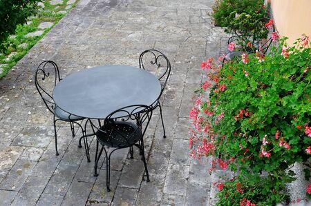 garden chair: Summer garden  terrace with pink flowers