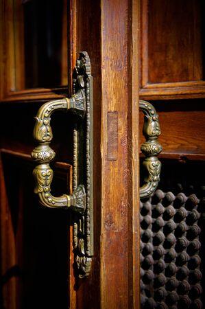 door handle: old  handle on wooden door