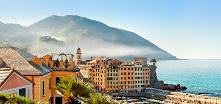 panoramic view: Panoramic view on top of the town Camogli in the morning fog Stock Photo