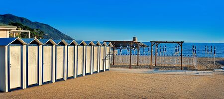 idyll: Beach cabanas on the seafront with blue sky Stock Photo