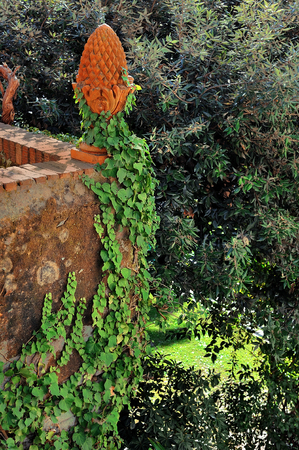 garden design: terracotta garden  sculpture with ivy