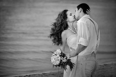 historical: loving couple retro styled  kissing on the shore