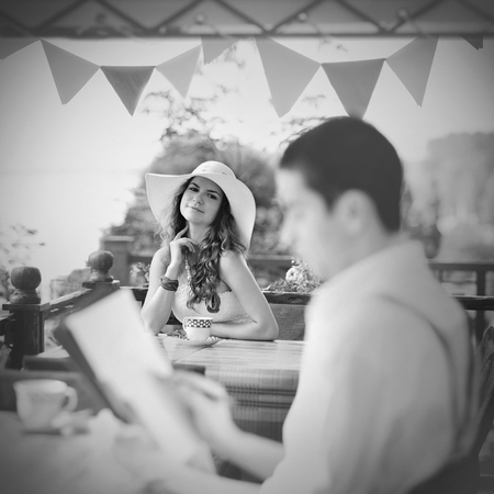 conceived: A girl poses on the terrace summer cafe for painter Stock Photo