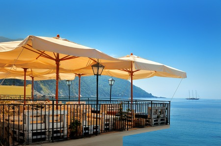 horizon reflection: Summer sea terrace  bar with umbrella