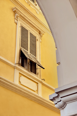 the detail: Italian Architecture detail with shuttered window on yellow facade