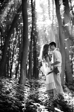 loving couple: Loving couple kissing in the forest with sun rays
