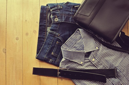 leather pants: mens clothing worn wooden background