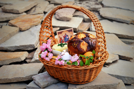 Easter basket on the gray stone background