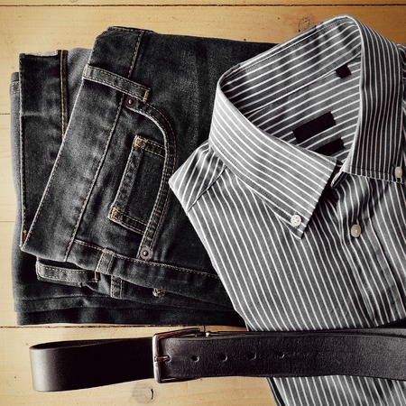 leather pants: Man items flat on wood background monochrome