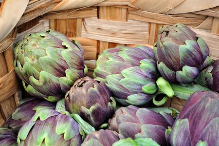 roman beans: fresh artichokes in woven basket macro