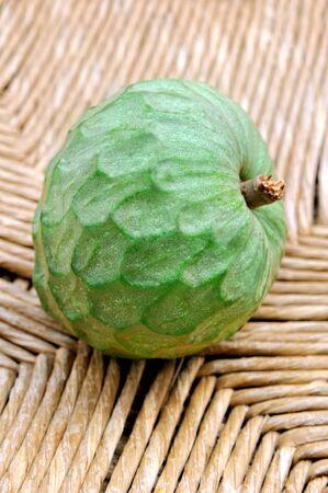 chirimoya: exotic fresh green fruit cherimoya on Woven background Stock Photo