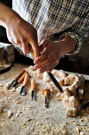 carver: carver in workshop carving with manual chisel