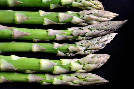 rustic food: vegetarian raw food asparagus rustic black background Stock Photo