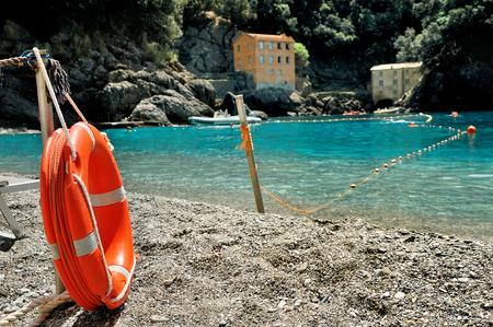 orange rescue circle at the sea gulf beach Stock Photo