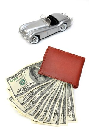 blured: Wallet with US Dollars and blured old car background Stock Photo