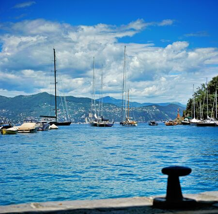 moor: Sea coast with moor, boats and yacht in Portofino, Italy