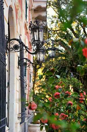 street garden lamps on facade with flowers Stock Photo