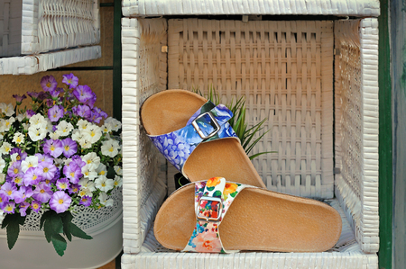 Womens sandals cortical outsole with floral print in woven box with flowers Stock Photo