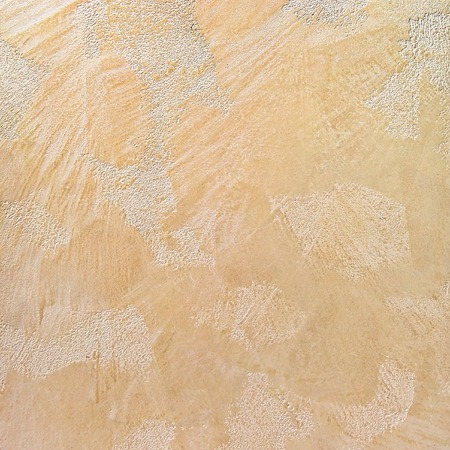 abstract rough effect neutral beige wall plaster background