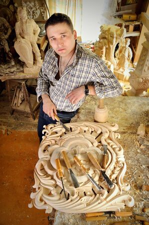 carver: Portrait of young carver in workshop with woodworking