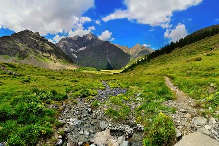 mountain streams with rocks in alpien mountains Valle dAosta, Italy, Europe