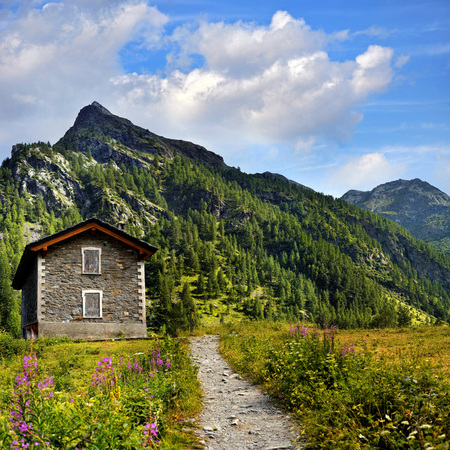 old shelter in in mountains landscape near Rhemes Notre Dame Stock Photo